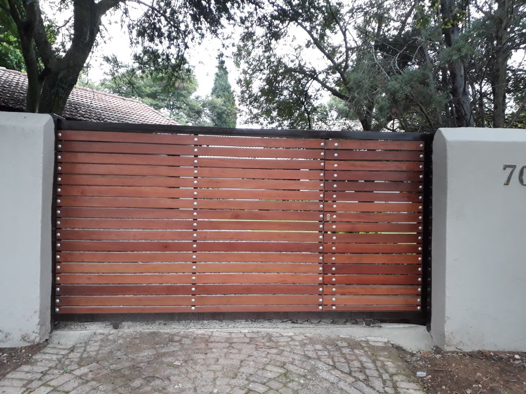 Wooden sliding gates by amazinggates.co.za